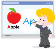 Schoolboy at the interactive whiteboard. Elementary school student writing on the interactive whiteboard Royalty Free Stock Images