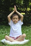 Schoolboy and joga Stock Image