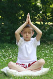 Schoolboy and joga Royalty Free Stock Photography