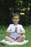 Schoolboy and joga Stock Photos