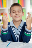 Schoolboy keeps fingers crossed Royalty Free Stock Images
