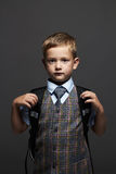 Schoolboy with knapsack.stylish funny child in suit and tie. ready to school. Schoolboy with knapsack.stylish funny child in suit and tie. fashion kids.ready to Royalty Free Stock Images