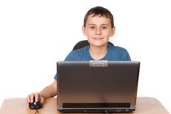 Schoolboy at the laptop Stock Photography