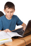Schoolboy at the laptop Stock Images