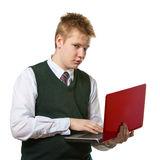 Schoolboy  with the laptop Royalty Free Stock Photography