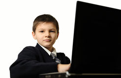 The schoolboy with laptop Stock Photo