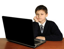 The schoolboy with laptop Royalty Free Stock Image