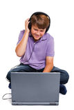 Schoolboy with laptop and headphones isolated Stock Photos
