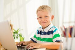 Schoolboy with laptop Royalty Free Stock Images