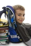 Schoolboy lean on school bag and book Royalty Free Stock Photos