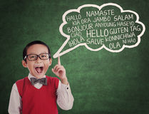 Schoolboy learn universal language Royalty Free Stock Photo