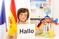 Schoolboy learning German at the light classroom Royalty Free Stock Image