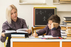 Schoolboy is learning with the teacher. Stock Photo