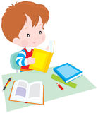 Schoolboy at lesson. Vector clip-art illustration of a boy reading a book at table Royalty Free Stock Images