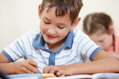 Schoolboy at lesson Stock Photo
