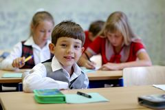 Schoolboy at lesson. Portrait pupil at lesson at classroom Royalty Free Stock Image