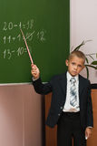 The schoolboy at a lesson of mathematics. The schoolboy solves examples at a mathematics lesson Stock Images