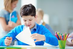 Schoolboy at lesson Stock Image