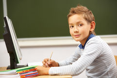 Schoolboy at lesson Stock Images