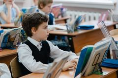 Schoolboy during the lesson stock image