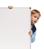Schoolboy looking out whiteboard Royalty Free Stock Photos