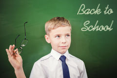 Schoolboy looking to blackboard with text of back to school Royalty Free Stock Photos