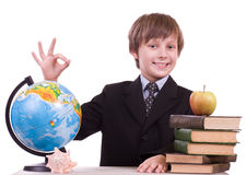 Schoolboy looks at a globe Stock Photo