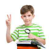 The schoolboy with loupe Royalty Free Stock Photo