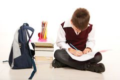 Schoolboy making homework Stock Photo