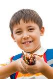 Schoolboy med kulöra blyertspennor Royaltyfri Foto