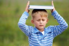 Schoolboy is meditating Stock Image