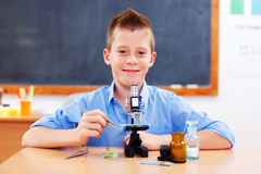 Schoolboy with microscope Royalty Free Stock Photo