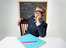 Schoolboy with mobile phone Royalty Free Stock Image