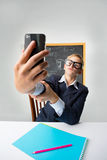 Schoolboy with mobile phone Stock Photography