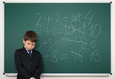 Schoolboy near the school board math solve Royalty Free Stock Images