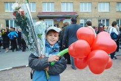 Schoolboy near school on September 1. Royalty Free Stock Photos