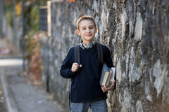 Schoolboy outdoors Stock Image