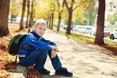 Schoolboy in park stock photos