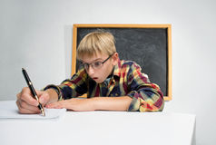 Schoolboy with a pen Stock Photos