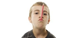 Schoolboy With a Pencil in His Mouth Royalty Free Stock Photos