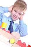 Schoolboy playing with bricks Royalty Free Stock Images