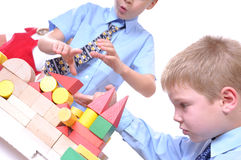 Schoolboy playing with bricks royalty free stock photo