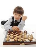 Schoolboy playing chess Stock Images