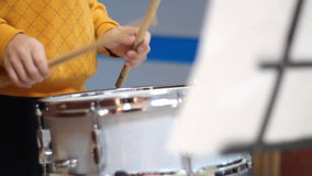 Schoolboy playing drum stock footage
