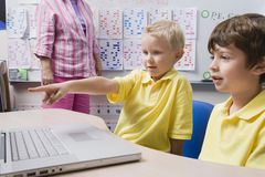 Schoolboy Pointing At Laptop Stock Images