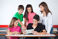 Schoolboy Pointing At Tablet With Classmates In Royalty Free Stock Photo