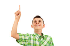Schoolboy pointing up, isolated on white Royalty Free Stock Image