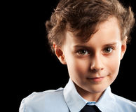 Schoolboy portrait. Portrait of a cute schoolboy isolated on black background Royalty Free Stock Photos