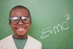 Schoolboy posing with the the mass-energy equivalence formula Royalty Free Stock Photo