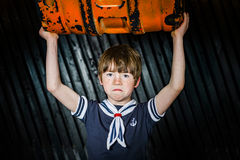 Schoolboy posing in sailor costume with emotions. Studio shooting Stock Photo
